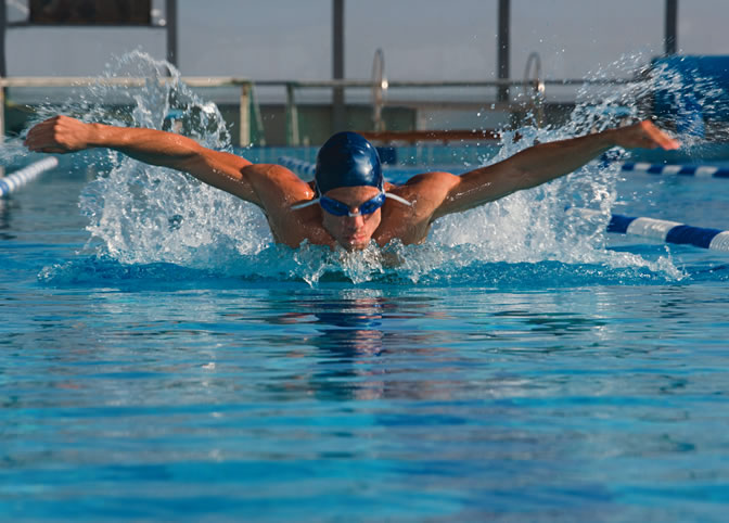 Man swimming butterfly stroke